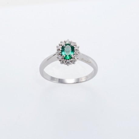 Anello a fiore in oro bianco con smeraldo e diamanti